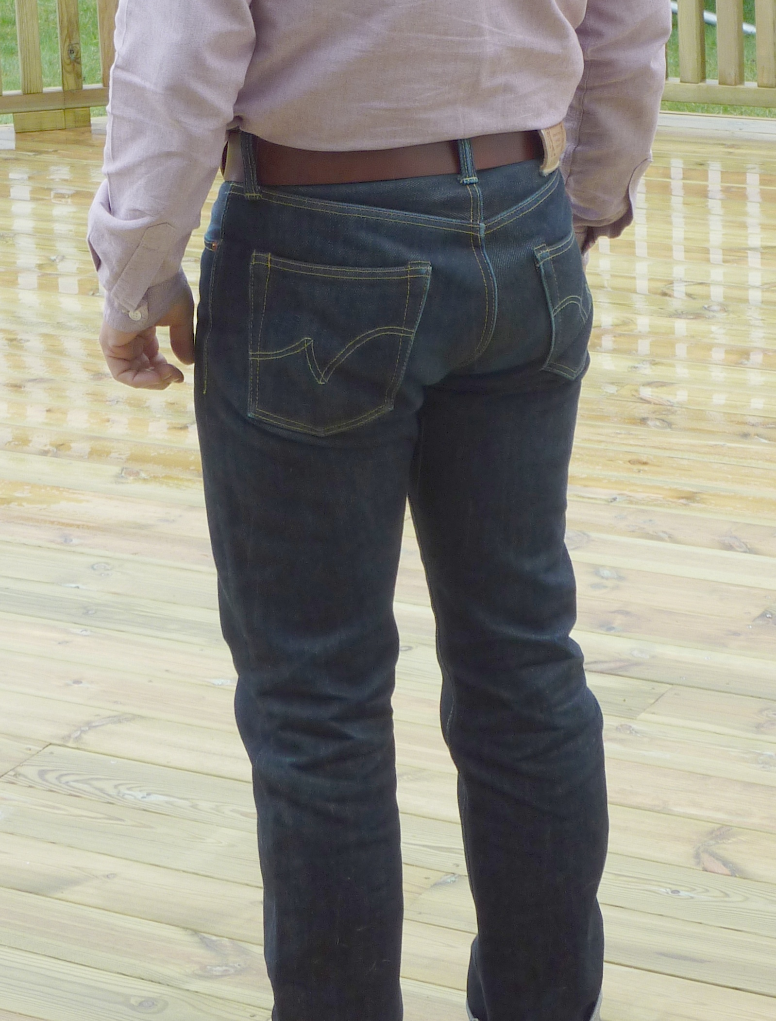 Professional posterior photo to illustrate butt-enhancing properties of the heavyweight denim.