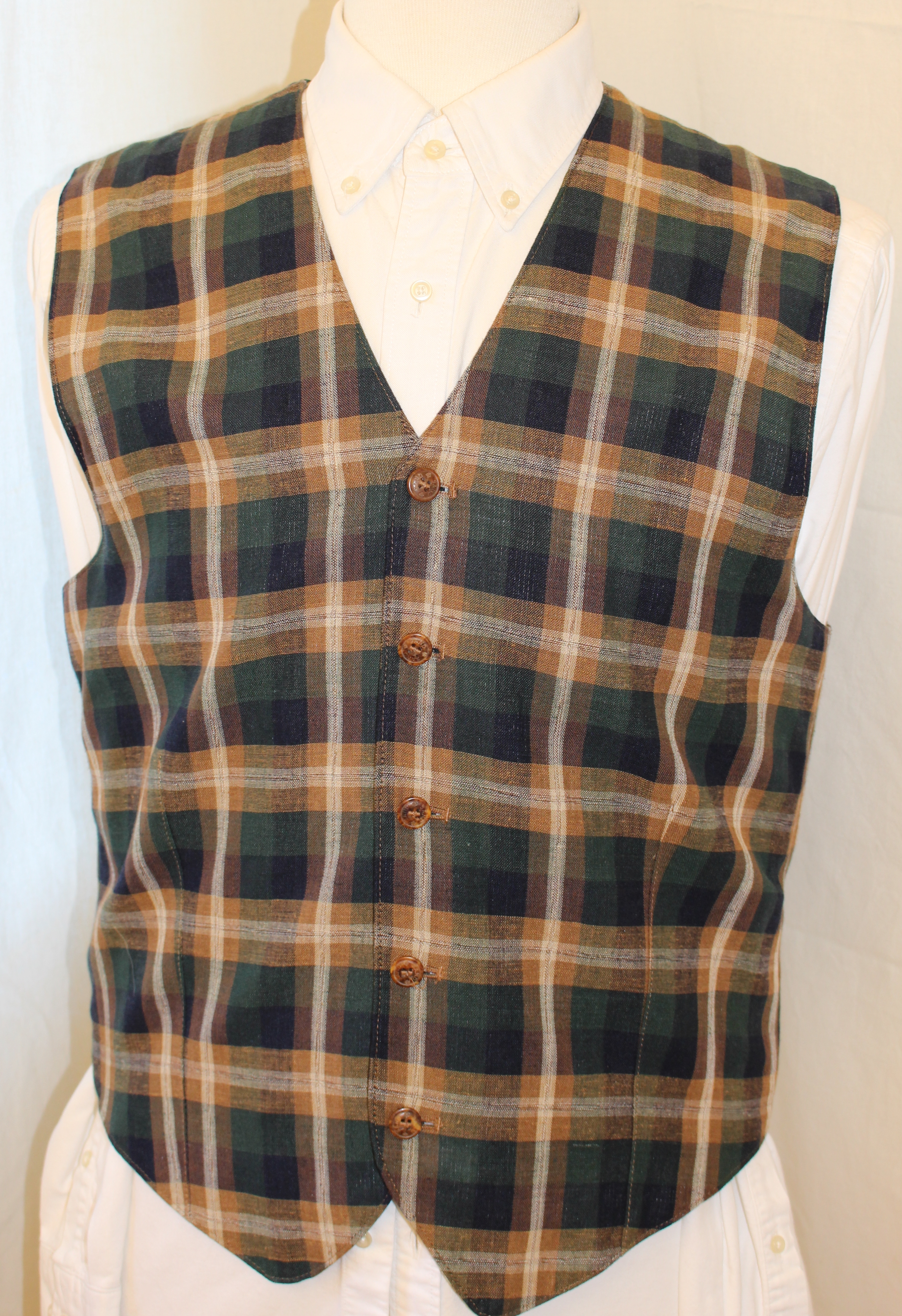 "Lovely madras check linen waistcoat by premium Danish menswear brand Sand. Sparingly worn. Size medium, P2P is xx"". Asking 55 pounds for this great Summer number."